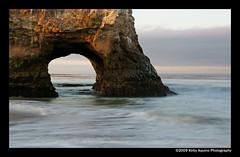 Ocean Arch (Kirby Aquino) Tags: ocean seascape sunrise carlzeiss landscapephotography 1680mm sonya700 stacruzca oceanarch