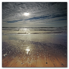 Beach (s0ulsurfing) Tags: ocean light sea wild sky cloud sunlight seascape reflection beach nature water beauty weather clouds reflections square relax island bay coast march sand solitude waves alone skies peace escape natural compton empty wide shoreline fluffy wave wideangle nopeople calm wash coastal filter shore foam vectis isleofwight getty coastline hanover grad isle chill 2009 squared nube wight meteorology nephology altocumulus westwight 10mm wavelet comptonbay sigma1020 nd4 s0ulsurfing abigfave vertorama mondocafeclub