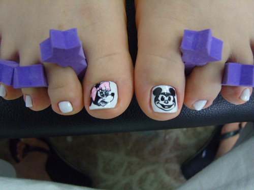 Minie & mickey toe nails on white toes pedicure design