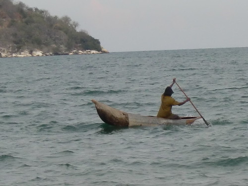 A fisherman in a dug-out canoe on Lake Malawi