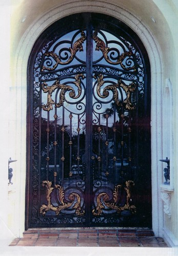 Custom Wrought Iron Entry Door With Bronze Leafs Included A Photo