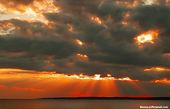 Sunset over Long Island Sound (Jeff Wignall) Tags: sunset sun inspiration storm weather clouds hope nikon god earth connecticut inspirational longislandsound raysoflight wignall stormyskies madisonconnecticut
