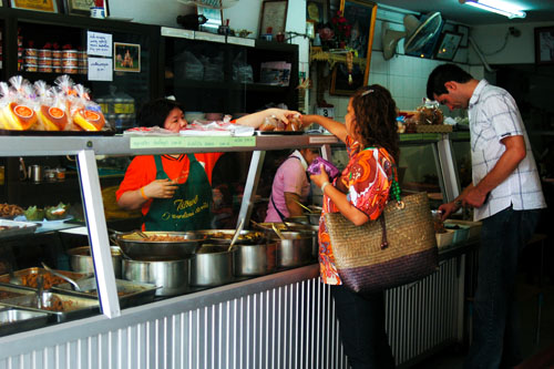 Ordering food to go at Dao Tai, a southern Thai restaurant in Thonburi, near Bangkok