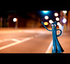 Gumby hails a cab. (Vitaliy P.) Tags: street hail project 50mm nikon long exposure bokeh cab taxi year2 365 f18 gumby month2 hailing project365 d80 vitaliyp simplefunnythings gumbyadventures