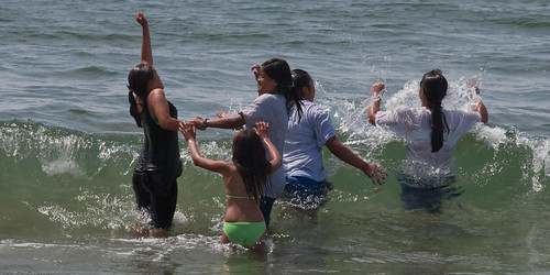 Hispanic family frolics in the surf in Morro Bay, CA  14 June 2009