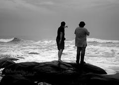 Look out (Sudhamshu) Tags: friends bw india men beach grey funny rocks waves explore chennai ashwin kovalam bayofbengal srivatsan