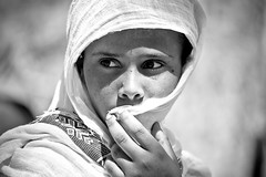 portrait of a girl  outside the St. Mary Zion Church in axum, tigray (anthony pappone photography) Tags: africa portrait people blackandwhite selfportrait black beautiful beauty kids barn canon children religious photography photo blackwhite photographer faces bambini expression retrato african picture culture afrika fotografia ethiopia orthodox celebrate ritratto blackgirl pilgrim axum celebrates reportage photograher afrique barna palmsunday eastafrica thiopien phototravel hosanna etiopia aksum abyssinia ethiopie etiope  etnica etnologia tigray afryka  etiopija  thiopie etiopien etipia  etiopi absoluteblackandwhite    5dmarkii  barnamyndataka stmaryzion  flickraward5  childrenbestphotos barnaljsmyndari barnamyndat