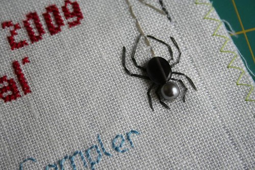 Band sampler detail: spider