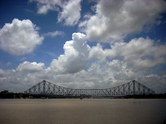 Cloud n  Bridge (ron de lightbox) Tags: pictures street morning bridge blue light sunset sea sky cloud india mist black color reflection nature beautiful festival 35mm photography corporate freedom boat marine cityscape photos indian duty independence kolkata puja calcutta moonsoon pictorial howrah comunication vehical repotage mbpictures flickrunitedaward