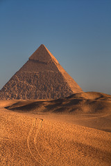 The Great Pyramid at Sunrise (chris_nevins) Tags: africa travel history sunrise sand ancient desert pyramid egypt cairo tamron giza sanddunes layover greatpyramid worldtravel deltaairlines supershot flickrsbest 7wondersoftheworld platinumphoto jfk7erflying 18270mm