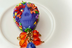 dia de los muertos pendant (Chili Crab) Tags: flowers blue red orange green leaves yellow dayofthedead skull one chili purple crystal handmade ooak violet crab jewelry kind fimo lilac clay diadelosmuertos etsy 2009 pendant polymer swarovsky