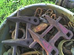 Bucket of rusted metal whatnots