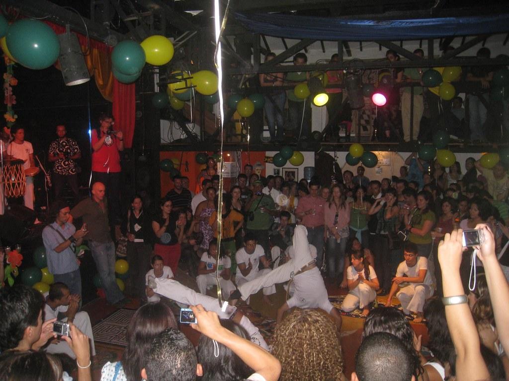 A high-energy capoeira performance during Brazil night at Teatro Matacandelas.