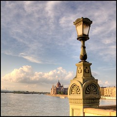 Let there be light! (PhatCamper) Tags: light sunset building water lamp architecture canon buildings boat spring hungary cityscape budapest parliament lamps monday duna parlament ungarn danube canond30 donau hungarian irfanview orszghz magyarorszg hungarianparliament hongrie szchenyilnchd 500x500 canoneos30d looneybin pseudohdr dunapart flickraward donauradwanderweg singlerawtonemapped platinumheartaward flickrestrellas absolutelystunningscapes  artistictreasurechest phatcamper platinumpeaceaward herowinner