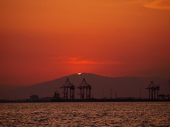 See you tomorrow... (EXPLORE FP) (dranidis) Tags: sunset red sea sky orange sun mountain water silhouette sparkles clouds port dark waves hand waterfront horizon silhouettes olympus cranes greece thessaloniki 43 dimitris salonica thessalonika saloniki salonika fourthirds thessalonica  explored  e520  olympuse520 gimp26 dranidis dimitrisdranidis