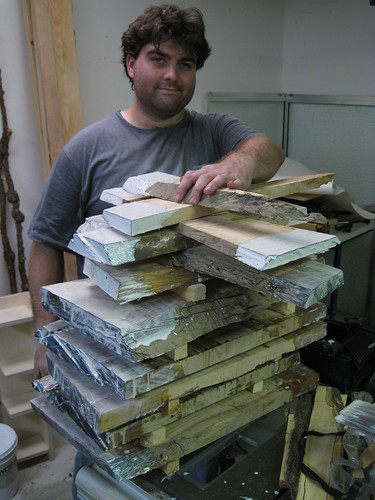 me and a stack of slabbed Eucalyptus logs