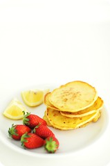"Rough Cottage Cheese ""Pancakes"" with Lemon and Strawberries for Breakfast"