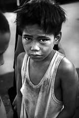 Manila - Street Boy of Baclaran Terminal (Mio Cade) Tags: poverty street boy shirtless game love station fence kid community child play sad god philippines poor dream stall dreaming sit manila disappointed buy attention bog atrisk sulk baclaran ternimal earthasia