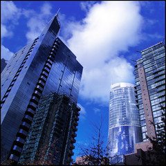 Ghost (ecstaticist) Tags: city blue sky urban cloud distortion canada reflection glass wall architecture vancouver floors skyscraper photoshop lens bc floor angle shimmery centre wide center columbia illusion british tungsten hdr alignment shimmy 3x photomatix