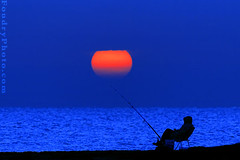 Fishing Sun (A.alFoudry) Tags: morning blue winter light sea orange sun man color beach water colors canon landscape eos lights fishing fisherman chair alone gulf shore silence fisher land third kuwait usm arabian scape ef kuwaitcity kuwaiti arabiangulf thirds q8 30d abdullah 400mm    kuw canoneos30d q80 q8city f56l  xnuzha alfoudry canonef400mmf56lusm  abdullahalfoudry kuwaitbeach foudryphotocom