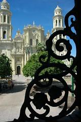 Catholic Church through the detail of the Iron Gazebo, Town Square, Hermosillo, Sonora, México, at Plaza Zaragoza