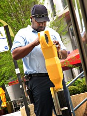 Hat, Shades, Bluetooth [PhotoChallenge.org 2009, Day 112] (Scott Coulter) Tags: street atlanta hat yellow canon georgia candid repair worker s2is buckhead photochallenge photochallengeorg 2009challenge 2009challenge112