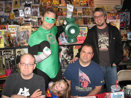 Green Lantern and Supergirl pose with artists.