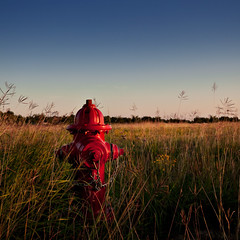 a lonely business (b*wag) Tags: light sunset red grass hydrant square landscape texas katy natural tx chain explored