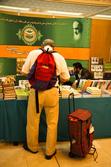 Book Lover (hapal) Tags: man bag book iran fair iranian annual behind tehran  briefcase knapsack       canoneos40d  hamidnajafi