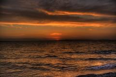 Golden Garden Beach, Seattle (Rachit's) Tags: seattle sunset sea vacation sky orange cloud color tourism nature water colors beautiful clouds rebel evening us washington scenery earth space horizon wa dslr scape hdr seatte waterscape xti