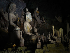 Sacred Lao style Buddhas in Pak Ou caves (Bn) Tags: nirvana pray offering meditation laos sacredsite 16thcentury zaklamp grot pakoucaves buddhastatues banpakou mywinners aplusphoto thamtingcave lightincense collectionofpilgrimsandlocals mostlywoodenbuddhas 25kmfromluangprabang 2500buddhas thamtheungcave impressivelaostylebuddhasculpture shakethefortunesticks collectionsofoldbuddhas visitbyboat senseitsatmosphere