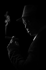 Davee with a cigar (Kkozi) Tags: blackandwhite bw hat smoke cigar smoking blackman mafia blackguy seriousexpression