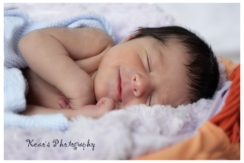 Somebody is happy to get a newborn session