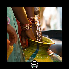 Indian summer (ayashok photography) Tags: india water nikon women bangalore problem pot bagles bangles watersupply nikonstunninggallery plasticpots nikond40 ayashok nikor55200mm rajastannomadscamp