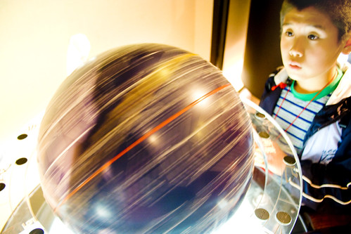 """Boy and Spinning Globe"" by Sprengben on flickr"