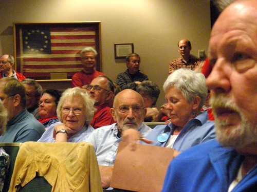 Arliss Sturgulewski, Vic Fischer, Jane Angvik, and Chuck OConnell (in foreground) at the June 9, 2009 Anchorage Assembly hearing. All four testified that night in support of the ordinance.