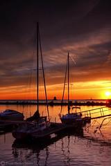 Lakeside Sunset (tsechel) Tags: sunset ohio summer lake reflection water sailboat marina reflections boats lakeerie lakeside greatlakes blackriver ripples powerboat lorain lorainlighthouse loraincounty canon24105mmf4l canon50d milelongpier 6gnd 9gnd