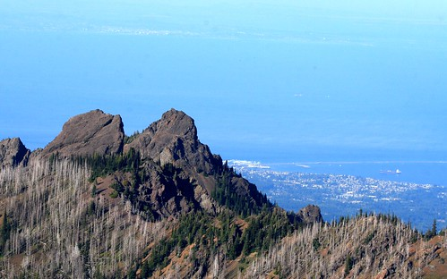 Denuded mountains in Olympic National Park, Port Angeles, and Victoria B.C. way in the distance