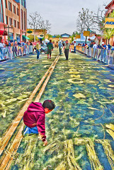 kid with yellow chalk - Amgen Tour of California (Chris Yarzab) Tags: street boy art yellow chalk kid nike amgen livestrong hoperidesagain