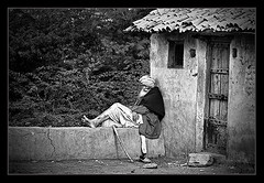 (Divs Sejpal) Tags: life old people bw india house man monochrome still gate asia alone peace village time age thinking rest lonely idle locked standstill gujarat kutch ummar divs divyesh divssejpal sejpal gaidho gadhpan