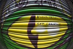 Shutter (Viveca Koh FRPS) Tags: street city uk urban streetart green london eye pasteup yellow painting graffiti photographer graphic capital fisheye artists shoreditch shutter metropolis graff koh eastlondon photographerlondon viveca getcreative blackallstreet fuckartist