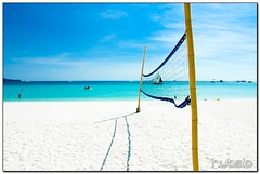wanna play? (hubsio) Tags: ocean shadow sea sky white net beach sports clouds sailboat nikon d70 blu volleyball boracay nikkor whitesand thehub paraw 18200vr hubsio hubertsio