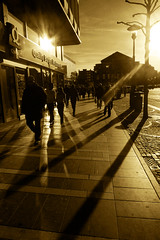 City of Blinding Lights (Gilderic Photography) Tags: street city light shadow people sun reflection monochrome silhouette sepia backlight u2 lumix mono soleil spring opera europe theater place belgium belgique belgie perspective ombre panasonic lumiere blinding toned rue quick liege reflets contrejour passant aplusphoto lx3 dmclx3