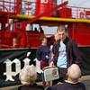 Young lad shows off his Bush radio to a sceptical pair (Niles Crane) Tags: radio pier 60s pentax tamron essex harwich pirateradio 18250 radiocaroline k100d piratebbcessex boatthatrocked