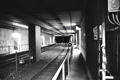 direction Bochum main station (mkniebes) Tags: blackandwhite underground geotagged tube ilfordhp5 sw x700 hp5plus tokina2870mm geo:lat=51472308 geo:lon=7214756