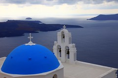 The blue domes of Santorini () (... Arjun) Tags: blue summer sky 15fav white seascape storm colour church topf25 wall clouds 1025fav bells 510fav easter landscape island iso100 volcano worship europe glare colours cross horizon aegean 100v10f christian unescoworldheritagesite worldheritagesite santorini greece 55mm 2550fav 500v50f caldera dome 50100fav 1000v100f orthodox volcanic 2009 dazzle eruption merge cyclades thira jesuschrist fira heavenonearth f9 dazzling thera ruleofthirds imerovigli neakameni firostefani aegeansea paleakameni thirasia canonef24105mmf4lis bluelist 100200fav  canoneos5dmarkii canon5dmarkii notioaigaio gettyvacation2010