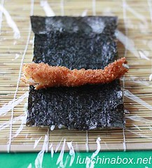 Filling the fried shrimp sushi roll
