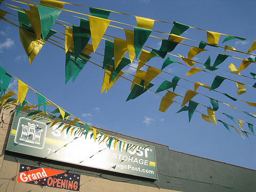 Green and Yellow Flags - Grand Opening