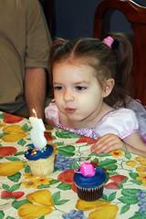 A backwards three (ahhhrats) Tags: birthday blue party 3 three candle julia princess blowing cupcake pigtails backyardigans uniqua