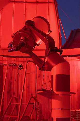 Celestron C-14 Schmidt Cassegrain telescope at the Richard D. Schwartz Observatory at the University of Missouri - Saint Louis, in Normandy, Missouri, USA - view with red lighting
